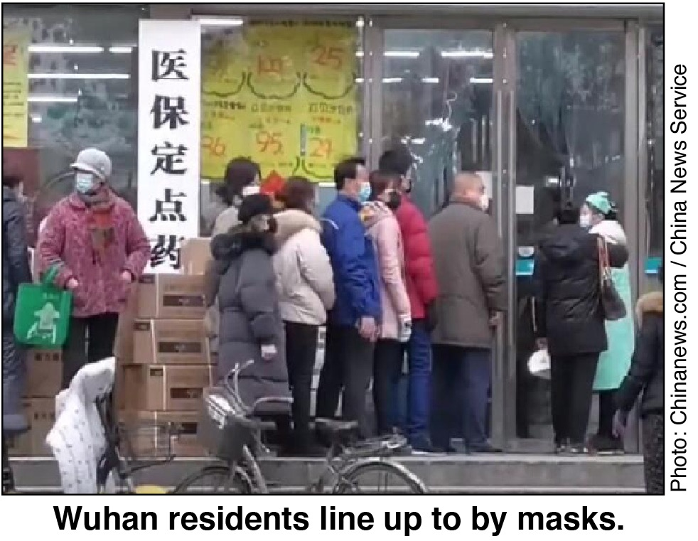 Wuhan residents line up to buy masks.